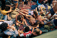 """Watkins Glen, NY. July, 1973.Naked man lying on a a blanket with other people during the Summer Jam at Watkins Glen was a 1973 rock festival which once received the Guinness Book of World Records entry for """"Largest audience at a pop festival."""" An estimated 600,000 rock fans came to the Watkins Glen Grand Prix Raceway outside of Watkins Glen, New York on July 28, 1973, to see The Allman Brothers Band, Grateful Dead and The Band perform.<br /> Similar to the 1969 Woodstock Festival, an enormous traffic jam created chaos for those who attempted to make it to the concert site. Long and narrow country roads forced fans to abandon their vehicles and walk 5–8 miles on that hot summer day. 150,000 tickets were sold for $10 each, but for all the other people it was a free concert. The crowd was so huge that a large part of the audience was not able to see the stage; however, twelve huge sound amplifiers, installed courtesy of legendary promoter Bill Graham, allowed the audience to at least hear."""