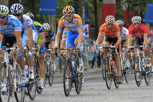 The peloton speeds down the Champs-Elysees during the final Stage 20 of the 2010 Tour de France running 102.5km from Longjumeau to Paris Champs-Elysees, France. 25th July 2010.<br /> (Photo by Eoin Clarke/NEWSFILE).<br /> All photos usage must carry mandatory copyright credit (© NEWSFILE | Eoin Clarke)