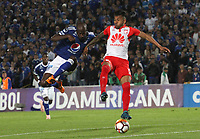 BOGOTÁ -COLOMBIA, 02-10-2018:Anier Figueroa (Izq.) jugador de Millonarios de Colombia disputa el balón con Wilson Morelo(Der.) jugador  de  Independiente Santa Fe  de Colombia durante partido de vuelta  por los octavos de final ,llave A,  de La Copa Conmebol Sudamericana 2018,jugado en el estadio Nemesio Camacho El Campín de la ciudad de Bogotá./Anier Figueroa (L) Player of Millonarios  of Colombia disputes the ball with Wilson Morelo (R) player of Independiente Santa Fe of Colombia during second return meeting game for the knockout round, key A, of the Conmebol Sudamericana Cup  2018, played at the Nemesio Camacho stadium The Campín of the city of Bogotá. Photo: VizzorImage/ Felipe Caicedo / Staff
