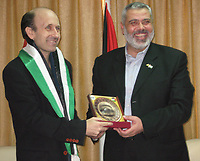"Ismail Haniyeh, the Hamas leader in Gaza and prime minister in the government dismissed by President Mahmoud Abbas, gives a gift to Alan Johnston (L), a BBC journalist, after he was released in Gaza July 4, 2007. Johnston, held hostage in the Gaza Strip since March, was handed over by his Islamist captors to ruling Hamas officials on Wednesday, Palestinian sources close to negotiations for his release said.""photo by Fady Adwan"""