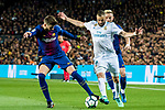Karim Benzema (C) of Real Madrid battles for the ball with Gerard Pique Bernabeu (L) of FC Barcelona during the La Liga 2017-18 match between FC Barcelona and Real Madrid at Camp Nou on May 06 2018 in Barcelona, Spain. Photo by Vicens Gimenez / Power Sport Images