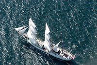 Kieler Woche:EUROPA, DEUTSCHLAND, SCHLESWIG- HOLSTEIN 22.06.2005:Kieler Woche, Artemis<br />Dreimastbark. <br /><br />Die Artemis wurde 1926 als Schiff für den Walfang gebaut und befuhr jahrelang die nördlichen und südlichen Polarmeere bis nach Spitzbergen und in die Beringsee. In den fünfziger Jahren wurde die Artemis dann zu einem Frachtschiff umgebaut und fuhr fortan hauptsächlich zwischen Asien und Südamerika. In einer aufwändigen Umbau- und Renovierungsphase steht das Schiff jetzt als komfortabler, wunderschön ausgestatteter Passagiersegler zur Verfügung.<br /><br /><br /><br />Luftaufnahme, Luftbild,  Luftansicht
