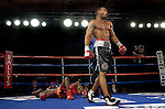 Kendall Holt  (r) celebrate after knocking  Isaac Hlatswayo down for the third  time during their Vacant NABO Junior Welterweight 12 rounds title fight at the Bally's hotel casino in Atlantic City, N.J. on 11.03.2006.&#xD;Holt won by unanimous decision and moved to 21 - 1.<br />