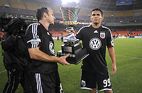 DC United forward Jaime Moreno (99) and defender Ryan Namoff (26)  holds the Atlantic Cup that was earned after defeating the New York Red Bulls.  DC United defeated the New York Red Bulls 2-0, at RFK Stadium ,Thursday June 4, 2009.