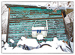 Old turquoise shack in Woodyard.