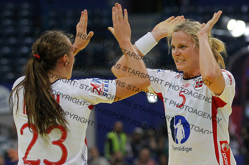 BELGRADE, SERBIA - DECEMBER 16: Ida Alstad (R) and Camilla Herrem (L) of Norway celebrates the goal during the Women's European Handball Championship 2012 gold medal match between Norway and Montenegro at Arena Hall on December 16, 2012 in Belgrade, Serbia. (Photo by Srdjan Stevanovic/Getty Images)
