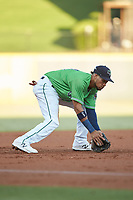 Gwinnett Stripers third baseman Pedro Florimon (18) fields a ground ball against the Scranton/Wilkes-Barre RailRiders at Coolray Field on August 16, 2019 in Lawrenceville, Georgia. The Stripers defeated the RailRiders 5-2. (Brian Westerholt/Four Seam Images)