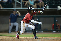 Yolbert Sanchez (29) of the Birmingham Barons follows through on his swing against the Mississippi Braves at Regions Field on August 3, 2021, in Birmingham, Alabama. (Brian Westerholt/Four Seam Images)