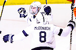 Penn State Michael Mcdonagh (8) celebrates Casey Bailey (18) goal in the second period. Penn State is leading 2-1 over RIT at Blue Cross Arena in Rochester, New York on October 20, 2012