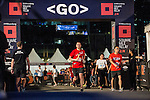 Runners participate at the Bloomberg Square Mile Relay near the Huangpu River in Shanghai, China.  Photo by Marcio Machado / Power Sport Images
