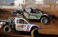 Apr 17, 2011; Surprise, AZ USA; LOORRS driver Marty Hart (15) races alongside Carl Renezeder (17) during round 4 at Speedworld Off Road Park. Mandatory Credit: Mark J. Rebilas-