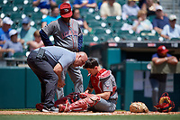 Lehigh Valley IronPigs catcher Rob Brantly (6) gets checked by athletic trainer Mickey Kozack after an injury, as manager Gary Jones looks on, during an International League game against the Buffalo Bisons on June 9, 2019 at Sahlen Field in Buffalo, New York.  Lehigh Valley defeated Buffalo 7-6 in 11 innings.  (Mike Janes/Four Seam Images)