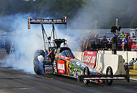 Aug 15, 2014; Brainerd, MN, USA; NHRA top fuel dragster driver Terry McMillen during qualifying for the Lucas Oil Nationals at Brainerd International Raceway. Mandatory Credit: Mark J. Rebilas-
