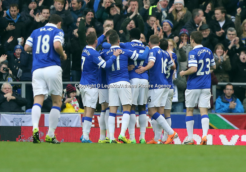 Pictured: Leighton Baines of Everton is celebrating his opening goal with team mates. Saturday 22 March 2014<br /> Re: Barclay's Premier League, Everton v Swansea City FC at Goodison Park, Liverpool, UK.