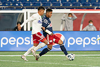 FOXBOROUGH, MA - OCTOBER 16: Damian Rivera #72 of New England Revolution II passes as Edwin Cerrillo #33 of North Texas SC comes in to tackle during a game between North Texas SC and New England Revolution II at Gillette Stadium on October 16, 2020 in Foxborough, Massachusetts.