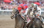 Willy Beamin, with Alan Garcia in the irons, wins the Foxwoods Kings Bishop Stakes at Saratoga Race Course on Travers Stakes Day  in Saratoga Springs, New York on August 25, 2012.