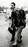 1984 File -<br /> <br /> Domenic Musitano: Charged with murder; Musitano  left the police station with coat over his head.<br /> <br /> Photo : Boris Spremo - Toronto Star archives - AQP