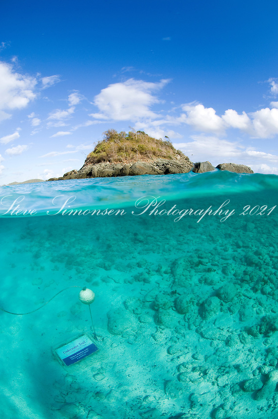 Split level view of Trunk Cay and the underwater snorkel trail marker.Virgin Islands National Park.St. John.U.S Virgin Islands.
