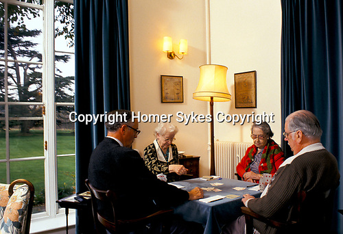 Residential Care Home for the elderly Watermoor House Cirencester Gloucestershire UK. 1990s. Playing Bridge.