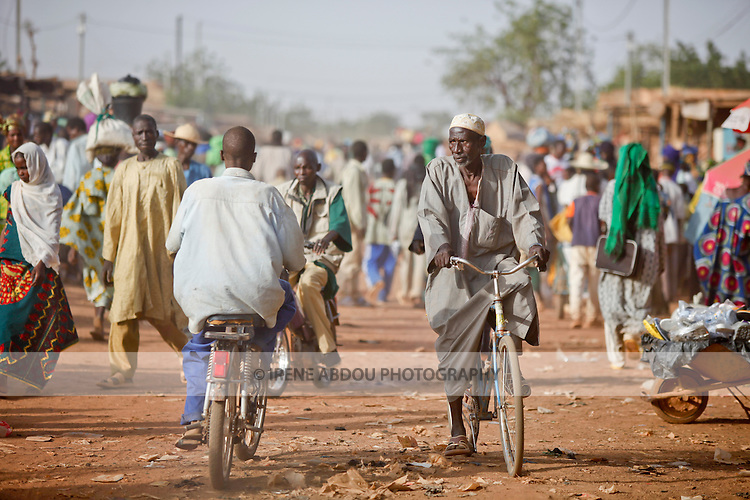 """In West Africa, certain villages have markets that """"assemble"""" at regular intervals, such as weekly or every three days.  People from villages around the region converge on the town of Djibo in northern Burkina Faso every Wednesday to buy and sell food, livestock, and other goods and services."""