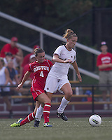 Boston College midfielder Kristen Mewis (19) dribbles while Boston University midfielder Brittany Heist (4) closely defends. After 2 complete overtime periods, Boston College tied Boston University, 1-1, after 2 overtime periods at Newton Soccer Field, August 19, 2011.