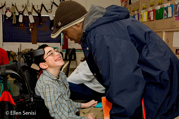 MR / Albany, NY.Langan School at Center for Disability Services .Ungraded private school which serves individuals with multiple disabilities.Teaching assistant (African-American) and student say good-bye. Boy: 11, cerebral palsy, expressive and receptive language delays.MR: Bro12, Wes2.© Ellen B. Senisi