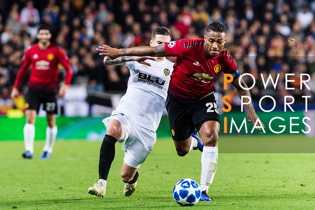 Antonio Valencia of Manchester United (R) is challenged by Santiago Mina Lorenzo of Valencia CF (L) during the UEFA Champions League 2018-19 match between Valencia CF and Manchester United at Estadio de Mestalla on December 12 2018 in Valencia, Spain. Photo by Maria Jose Segovia Carmona / Power Sport Images
