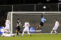 Virginia Cavaliers goalkeeper Diego Restrepo (1) dives for a shot by Wake Forest Demon Deacons Andy Lubahn (17)  during the first semi-final match of the 2009 NCAA Men's College Cup at WakeMed Soccer Park in Cary, NC on December 11, 2009.