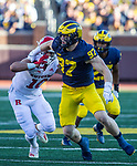 Michigan defensive end Aidan Hutchinson (97) maneuvers around Rutgers tight end Matt Alaimo (10) in the third quarter of an NCAA college football game against Rutgers in Ann Arbor, Mich., Saturday, Sept. 25, 2021. Michigan won 20-13. (AP Photo/Tony Ding)