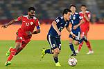 Doan Ritsu of Japan (R) is followed by Ahmed Al Mahaijri of Oman (L) during the AFC Asian Cup UAE 2019 Group F match between Oman (OMA) and Japan (JPN) at Zayed Sports City Stadium on 13 January 2019 in Abu Dhabi, United Arab Emirates. Photo by Marcio Rodrigo Machado / Power Sport Images