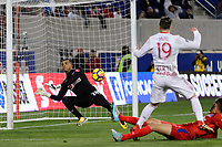 Harrison, NJ - Thursday March 01, 2018: Donis Escober, Alex Muyl. The New York Red Bulls defeated C.D. Olimpia 2-0 (3-1 on aggregate) during a 2018 CONCACAF Champions League Round of 16 match at Red Bull Arena.