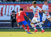 CARSON, CA - FEBRUARY 1: Ulysses Llanez Jr #19 of the United States turns and moves with the ball during a game between Costa Rica and USMNT at Dignity Health Sports Park on February 1, 2020 in Carson, California.