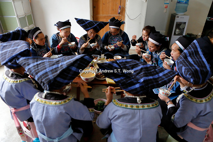 Women of the ethnic Bouyei Tribe have lunch at Wangmo County in China's southwestern Guizhou Province, April 2019.