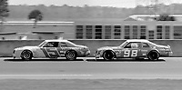 Dale Earnhardt leads atwo car draft during a Sportsman race at Daytona in February 1982. (Photo by Brian Cleary)