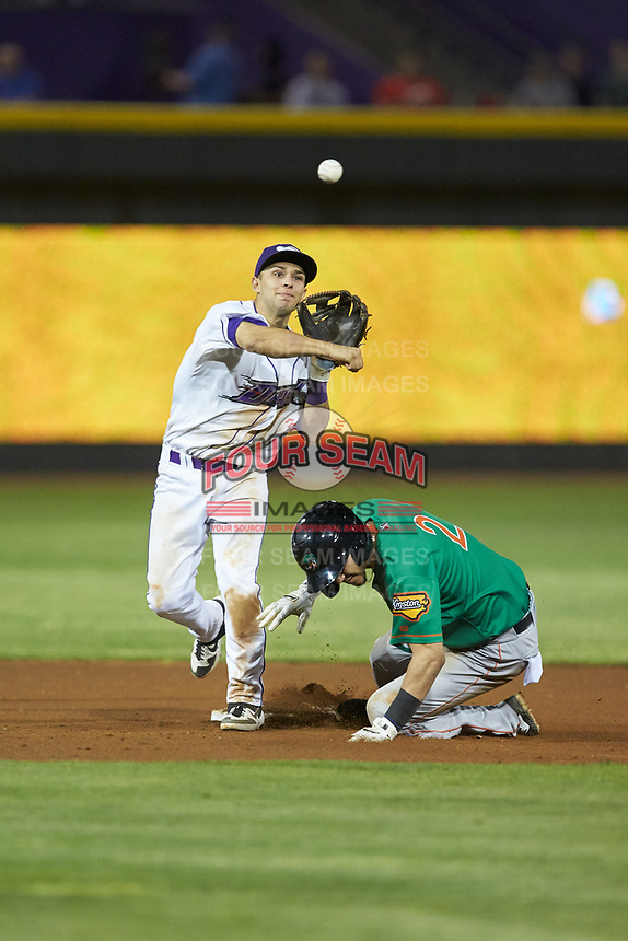 Nick Madrigal (3) of the Winston-Salem Dash makes a throw to first base as Anderson Tejeda (2) of the Down East Wood Ducks slides into second base at BB&T Ballpark on May 10, 2019 in Winston-Salem, North Carolina. The Wood Ducks defeated the Dash 9-2. (Brian Westerholt/Four Seam Images)