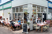 UK. London. 17th July 2010.Diners at Brixton Cornercopia..©Andrew Testa for the New York Times