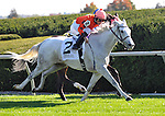 Tapitsfly and Jose Lezcano win the First Lady at Keeneland Racecourse.October 6, 2012.