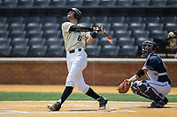 Jake Mueller (6) of the Wake Forest Demon Deacons follows through on his swing against the Pitt Panthers at David F. Couch Ballpark on May 20, 2017 in Winston-Salem, North Carolina. The Demon Deacons defeated the Panthers 14-4.  (Brian Westerholt/Four Seam Images)