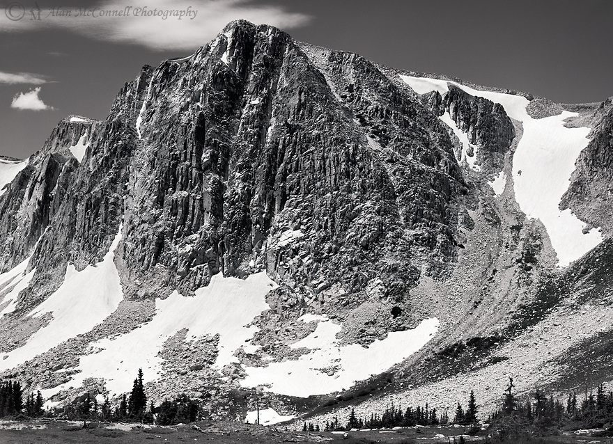 """Hiking along the Snowy Range Ridge back to the trailhead, I found my eye constantly being drawn up to this magnificent peak called """"Old Main.""""  The strong triangular shape, along with textures of the vertical wall makes this a stunning formation."""