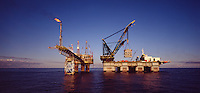 Oil industry. North Sea. Heavy lift. Semi-submersible crane barge lifting 800 ton module onto oil production platform..