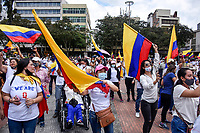 ARMENIA - COLOMBIA, 01-05-2021: Cientos de manifestantes agitan banderas de Colombia en la Plaza de Bolívar de la ciudad de Armenia durante la jornada del Día del trabajo en Colombia hoy, 01 de mayode 2021, además se mantiene la protesta por la reforma tributaria que adelanta el gobierno de Ivan Duque además de la precaria situación social y económica que vive Colombia. El paro fue convocado por sindicatos, organizaciones sociales, estudiantes y la oposición y sumando el día del trabano lleva 4 días de marchas y protestas. / Hundreds of people wave a Colombian flag at Plaza de Bolivar of the city of Armenia during the day of Labor Day in Colombia today, May 1, 2021, in addition, the protest against the tax reform that the government of Ivan Duque is advancing in addition to the precarious situation is maintained. social and economic life in Colombia. The strike was called by unions, social organizations, students and the opposition and adding the day of labor has 4 days of marches and protests. Photo: VizzorImage / Santiago Castro / Cont
