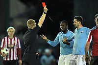 Referee Carl Fitch shows a red card to Joe Benjamin of Billericay (C) - AFC Hornchurch vs Billericay Town - Blue Square Conference South Football at The Stadium, Upminster Bridge, Essex - 29/12/12 - MANDATORY CREDIT: Gavin Ellis/TGSPHOTO - Self billing applies where appropriate - 0845 094 6026 - contact@tgsphoto.co.uk - NO UNPAID USE