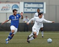 University of Connecticut midfielder Adria Beso (11) dribbles at midfield as Creighton University midfielder Bruno Castro (7) closes..NCAA Tournament. Creighton University (blue) defeated University of Connecticut (white), 1-0, at Morrone Stadium at University of Connecticut on December 2, 2012.