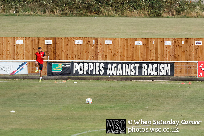 Declan Towers of kettering warms up next to an anti racism banner. Kettering Town 1 Leiston 2, Evo Stick Southern League Premier Central, Latimer Park. Kettering Town are a famous name in non-league football. After financial problems, relegations, and relocation, the club are once again upwardly mobile. Despite losing to Leiston, Kettering finished the season as Champions and were promoted to the National League North.