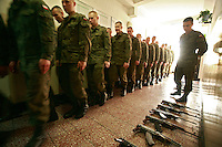 Soldeirs gathering for early morning assembly, with AK-47 Kalashnikov rifles laid out on the floor. This year's class of drafted recruits is the final one after 90 years of compulsory military service, as Poland's army turns professional in 2009.