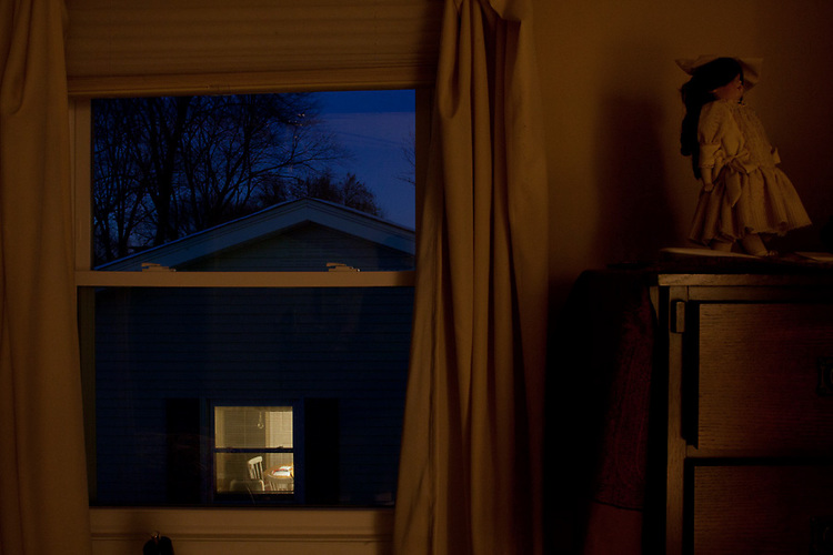 Inside two houses: the twilight view from my bedroom during winter. My grandmother's childhood doll is in the foreground.