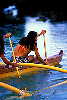 Young women in ocean near the Big Island in their outrigger canoe.