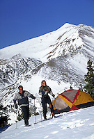 Winter, Vacation, Sports, Active Lifestyle, Adventure, Wilderness, Exercise, Fitness, Training, Cross Country Skiing, Telemark Skiing, Woman, Ski Touring, Fashion, Backpacking, Couple, Man. Couple (MR 648,614) Cross Country Skiing & Winter Camping. Backco