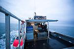 Lobster fishermen on the Bay of Fundy. (Credit: Robert van Waarden - http://alongthepipeline.com)