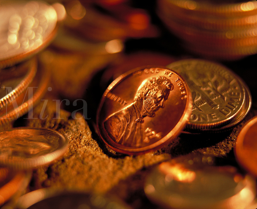 Close up of US coins, including pennies, dimes, and quarteres. United States.